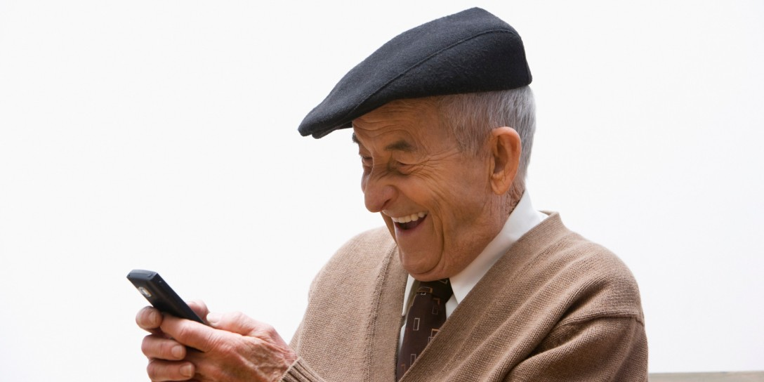 Senior, Hispanic man text messaging on cell phone